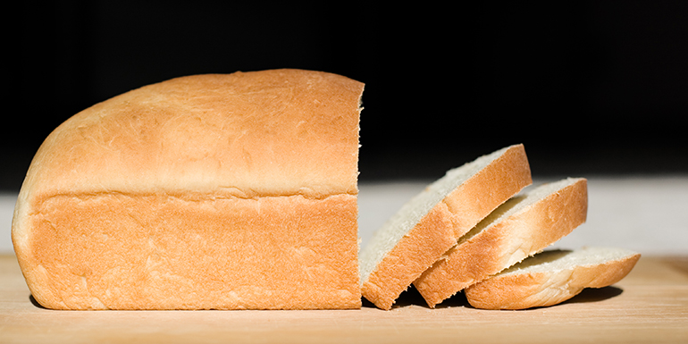 """Home made loaf of white bread, sliced.Similar:"""