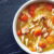 top down photo of chicken noodle soup with copy space on slate